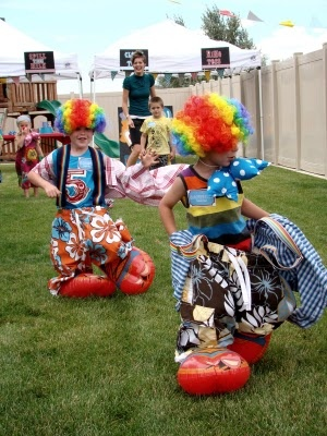 Fun clowning around game. Kids have to go to each station on a course to pick up a clown outfit and put it on. First fully dressed child to cross the finish line  wins.