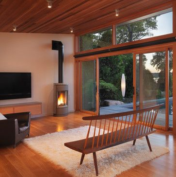 Modern poolside retreat finished with natural western red cedar flooring and ceiling   Flavin Architects