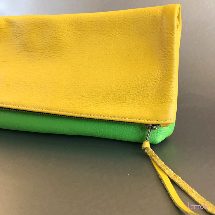 Vibrant and spacious, this large clutch will fit all your essentials and more. Makes for a great evening clutch, large makeup case, or organizer for your tote. Handmade in San Francisco. With limited