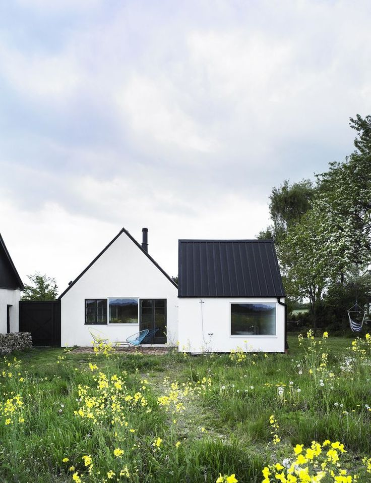 """Set in the Swedish summer retreat area of Österlen, this conversion of an abandoned farmhouse re-thinks and plays on the notion of """"nostalgia and shelter by combining them with very contemporary desires for space, light and nature,"""" say the architects. P"""