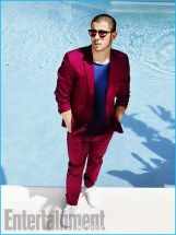 Nick Jonas wears shirt and suit Calvin Klein Collection, shoes Adidas and sunglasses Retrosuperfuture.