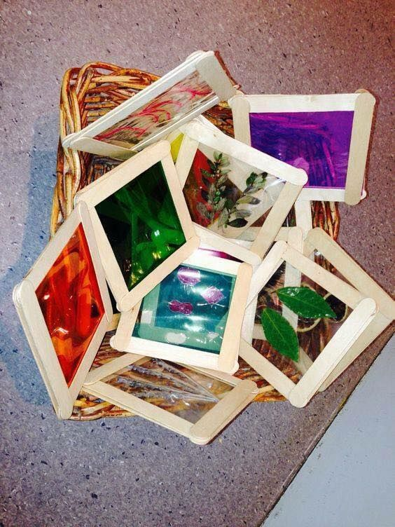 """From Learning and Exploring Through Play website: Make tiles with popsicle sticks and  """"cellophane for children to investigate either on a light box or against windows/outside """""""