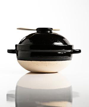 This beautiful Japanese ceramic rice cooker can be used at the stove or over a campfire.