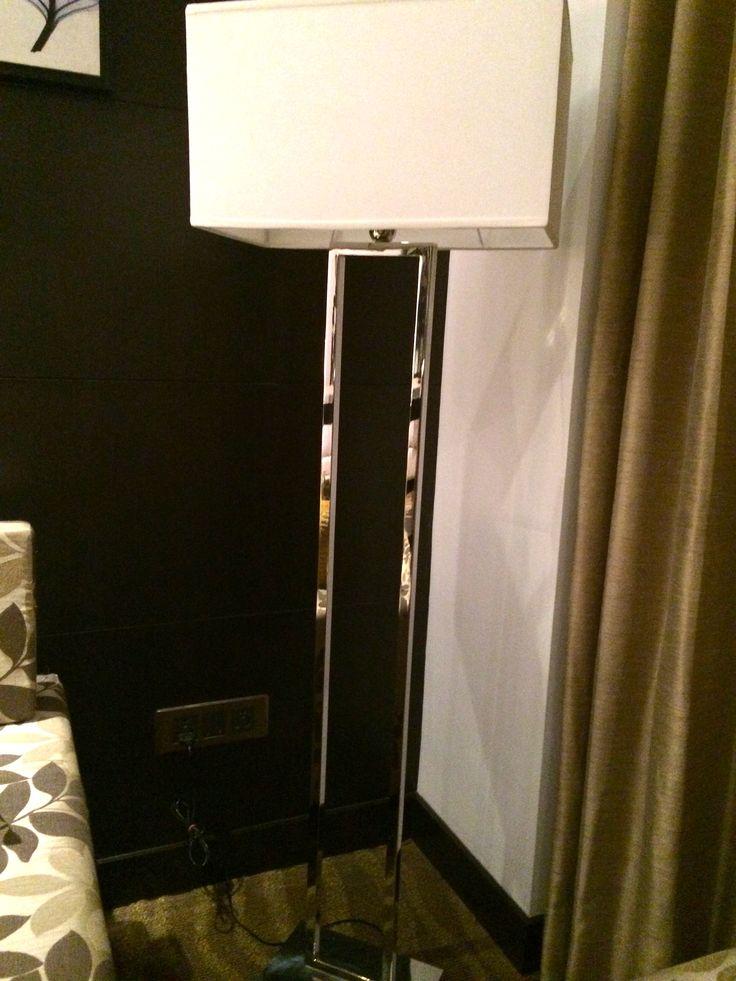 Floor lamp in chrome finish.