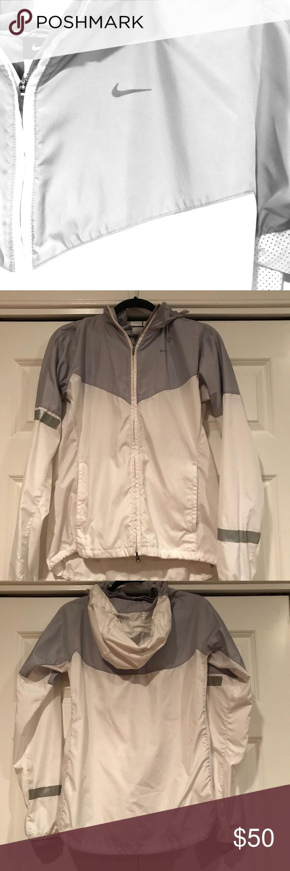 Nike Running Jacket Women's Nike running jacket. Two toned - gray/white Nike Jackets & Coats http://feedproxy.google.com/fashionshoes1