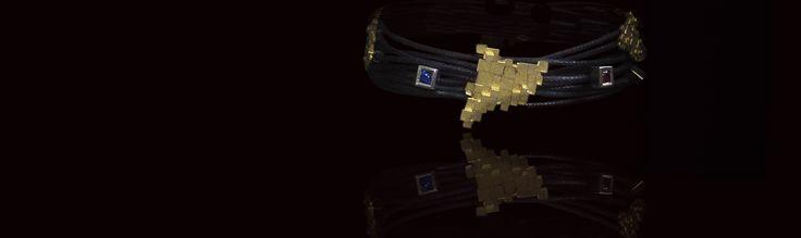 Fem peces úniques per encàrrec. A la imatge: Polsera or groc i or blanc 1a llei, amb safir blau i robí.