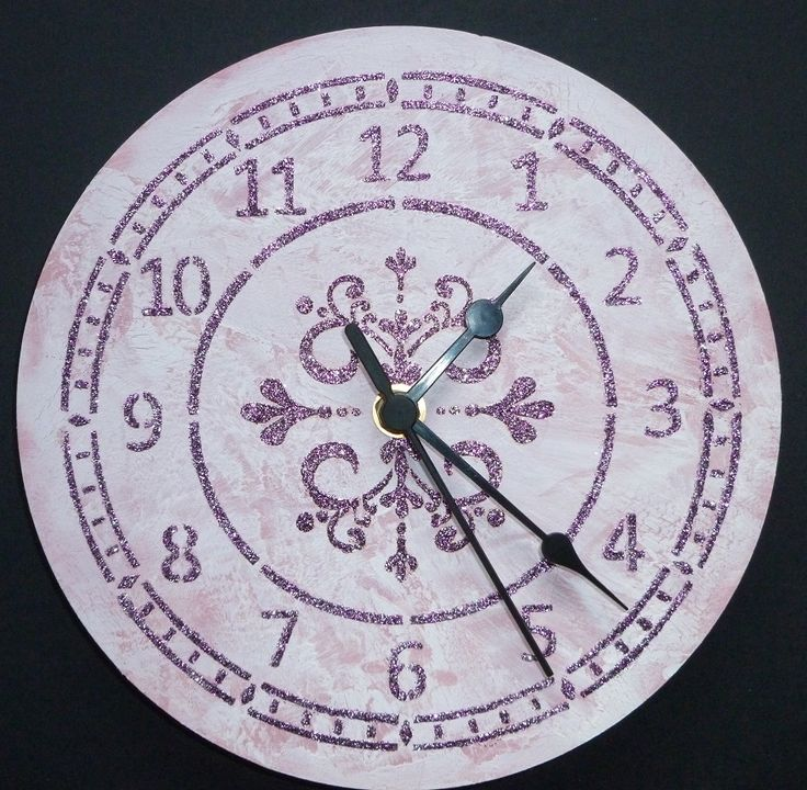'Large MDF pink, white, flourish clock.'  Imagination Craft's - Large MDF clock kit.  Large clock face stencil.  Small rounf flourish stencil.  Silver rose Sparkle Medium.   Metal spatula.   Chalk MDF paint.  Chalkiies - clover.  Crackle medium.   January 2015.
