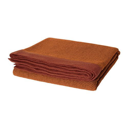 "HENRIKA Throw   - IKEA  $14.99  47"" x 71"" This throw might be the right accent burnt orange for the sofa in the TV room or for the master"