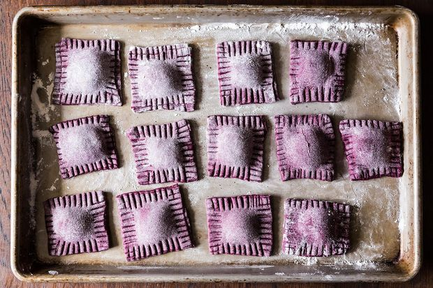 Beet ravioli with ricotta, goat cheese, and mint filling. Oh, how delicious and pretty.