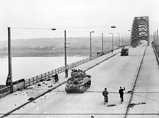 British Sherman tanks of XXX Corps crossing the bridge at Nijmegen, the Netherlands, 20 Sep 1944