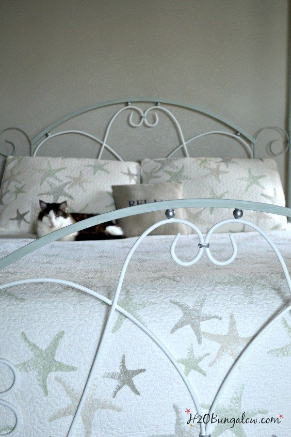 I'm sharing how to paint an iron bed frame and turn an old dark and tired bed into a stunning centerpiece. This project makes a huge impact in any makeover.