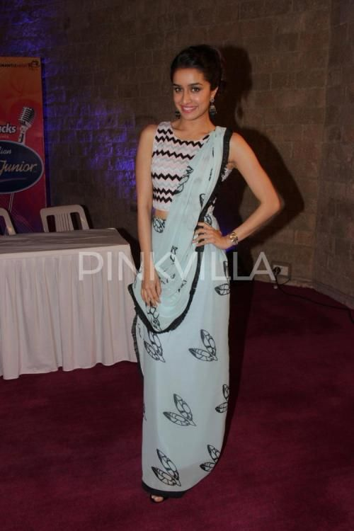 Shraddha Kapoor at 'Indian Idol Junior' Press Meet : Shraddha looked nice and pretty wearing Babita Malkani with black shoes and a wrist watch. Her hairstyle and makeup is perfect. She looked great.