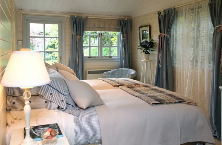 ISLE OF WIGHT: The Island Hideaway luxury self-catering from www.uniquehomestays.com.  Fabulous blue-grey bedroom decorated in a country classic style.