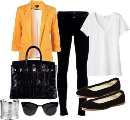 """Яркая деталь в образе """"забирает"""" на себя все внимание. Этот оранжевый пиджак можно носить с простой майкой и классическими черными брюками."""