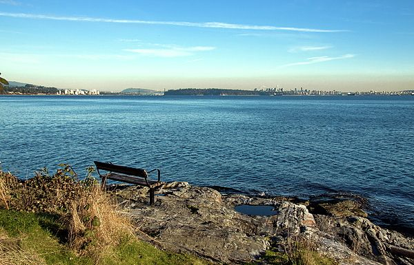North America Photograph - Bench On The Stony Bank by Alex Lyubar    #AlexLyubarFineArtPhotography #VancouverCanada #SeaRocksSkyLine #ArtForHome #FineArtPrint