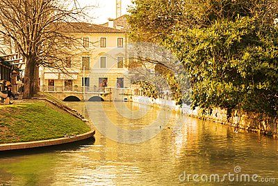 Treviso city and the river with historical architecture in warm hues, Treviso, north Italy, Europe.