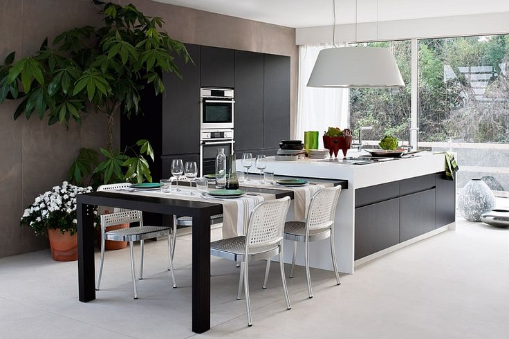 Extendable dining table that can be tucked away into the kitchen island Dynamic Modern Kitchen Balances Modularity With Chic Formal Elegance