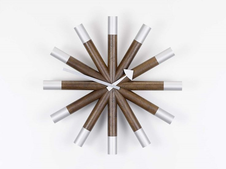 Wheel Clock by George Nelson  - Vitra Nelson Wall Clock - Designed by George Nelson, 1948-1960 Nelson Wall Clocks | Sapphire Spaces