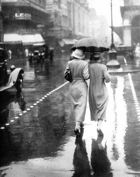 Strolling in the rain back in the olden days.  Pretty cool image