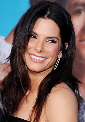 Sandra Bullock amps up the shine on her ultra-dark locks. Find out how to get your own #customized #hair #color at home here: http://www.haircolorforwomen.com/breakthrough-hair-color-system/