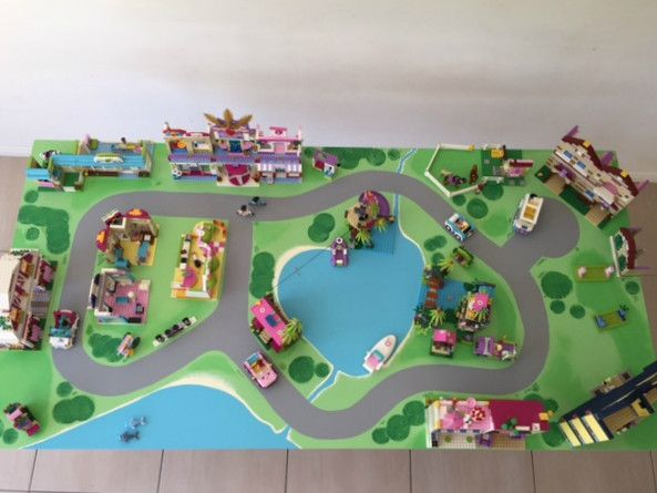 lego friends playmat - paint on plywood (or old wooden door) and slide under bed with sets made on it. handles on side to help slide in and out from under bed?