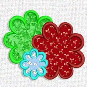 Here's a free embroidery design from Adorable Applique. Its a couple of flowers. All sorts of fun color options with this one.