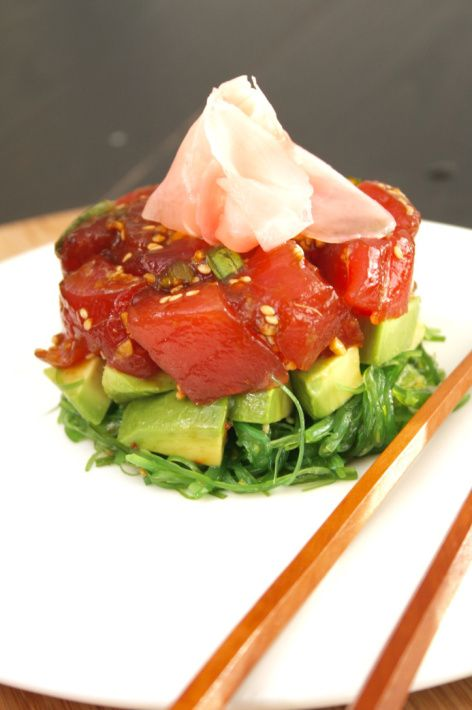 Fresh Ahi tuna poke with seaweed salad, avocado, and pickled ginger served with homemade wonton chips.
