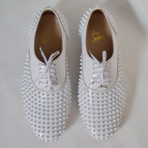 SIZE 37 AUTHENTIC CHRISTIAN LOUBOUTINS Size 37. Auth. CHRISTIAN LOUBOUTIN White Freddy Studded Patent Leather Laceup Oxfords. Patent leather body with lacquered spikes and waxed laces. Leather lining. Signature red leather sole. Padded insole. Made in Italy. Heel measures approximately 25mm/ 1 inch. There are minor scratches on the sole from store tryons only. I have the red Christian Louboutin bag for each shoe, I do not have the box. Christian Louboutin Shoes
