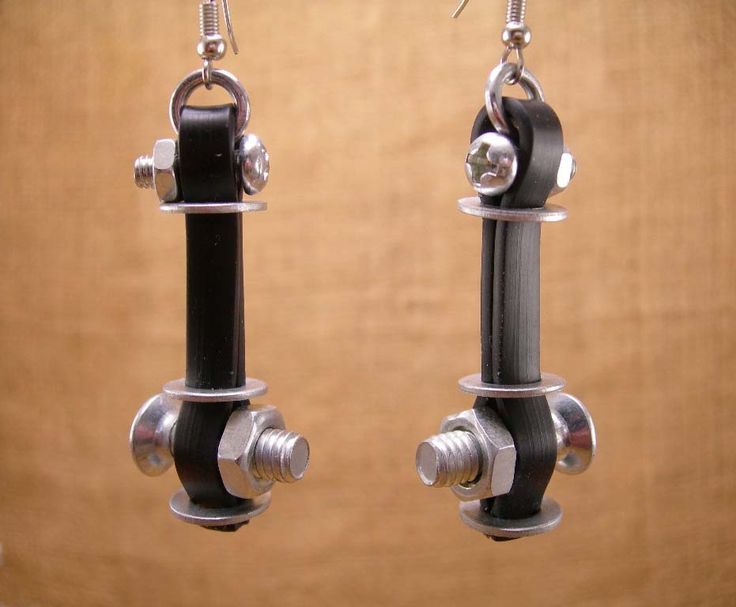 Handmade Industrial Hardware Earrings with washers- hex nuts- screws -flat rubber cord- Stainless steel ear wire hooks.   https://www.etsy.com/shop/ostriajewelry?ref=hdr_shop_menu