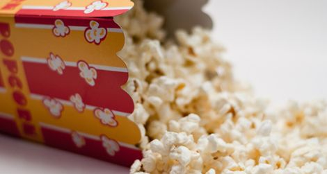 The history of popcorn is vast, and it intersects with movies in the relatively recent past–a symbiosis of taste and place created to save t...