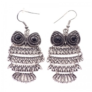 Silver colored owl earrings