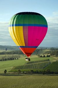 Greet the morning sun as you take flight over the Yarra Valley and its vineyards on a Yarra Valley hot air balloon flight!