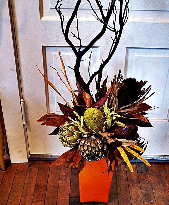 floral arrangements with manzanita | Dried banksia, artichokes, with manzanita branch  - More Great Ideas from DriedDecor.com