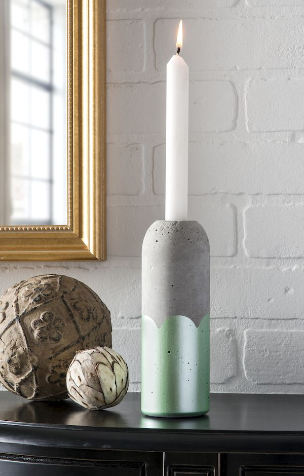 DIY Concrete Candle Holders Supplies  Quikrete Recycled bottles – any size and shape as long as the mouth is wide enough to fit a candle Bucket Sifter Candles Scissors Small saw Razor blade Cooking spray Small plastic container Wood shims (optional)