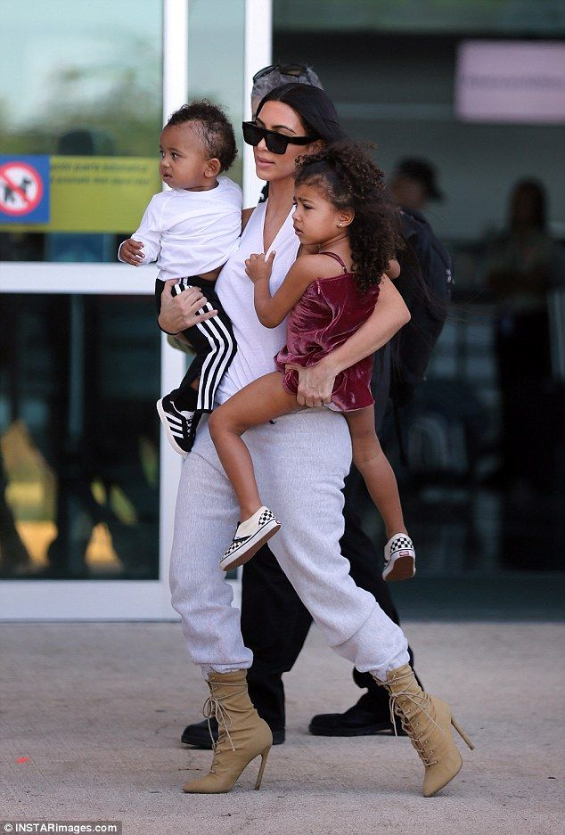 And they are off:Kim Kardashian showed some impressive mom skills as she carried both her babies in heels while moving at speedas they flew out of Costa Rica on Monday