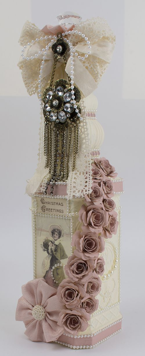 Taras Studio- Lovely, but would tone it down alittle, love the cascading roses on a tall bottle