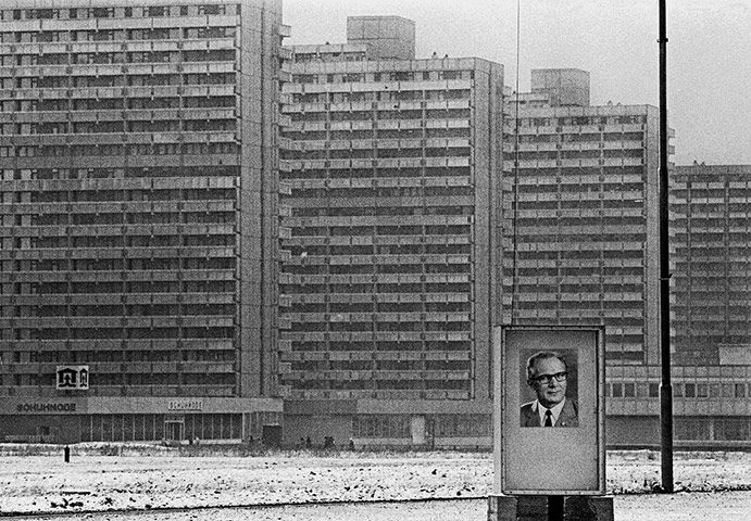 East Berlin apartment blocks in 1975, with poster showing leader Erich Honecker.