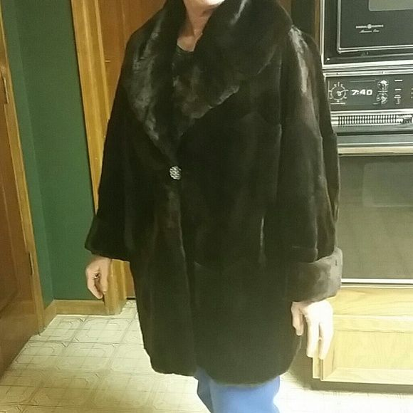 Gorgeous brown mink coat Dark chocolate brown authentic mink coat in gently used condition. The coat has been to cold storage and cleaned every year. A seam on the lower right side needs to be mended but it can be repaired easily. I inherited it and I never wear it even though it'd be gorgeous for a night out. It also has her name, Barbara, embroidered inside of a pocket but is only visible when pulled inside out. Price is negotiable Bergdorf goodman Jackets & Coats