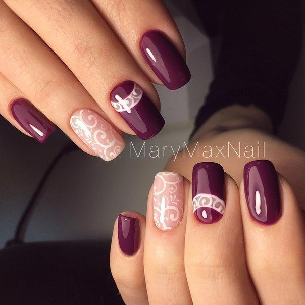 Marsala nails with detailed nail art.