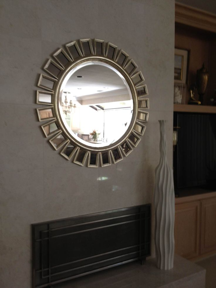 We love how Uttermost's Cyrus mirror, #14076 B, adds a bit of glam above the fireplace in our Kerrie Kelly Design Lab client's home!