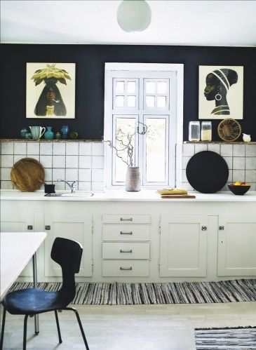 Danish kitchen: Arne Jacobsen chair + posters by Aage Sikker Hansen