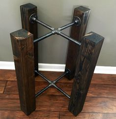 This is a beautiful Ebony black stained solid wood beam and iron pipe table base. You will add your own glass or concrete top! Base shown in photos measures roughly 27 diameter x 28 Tall, and would fit a round table top of 48 diameter. Check out other size options, WE CAN MAKE THIS ANY SIZE. Message us for custom! Does not come with a top or any attachments or pads for a top.
