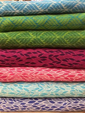 The first six official Nona Woven Wraps releases (and one tester for the may release at the bottom).