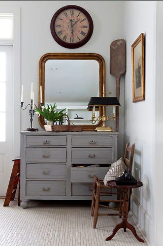 I love this painted gray dresser - Gray is one of my all-time favorite decor colors. It screams antique with a little flair.Also love the arrangement of mirror, clock and accessories.