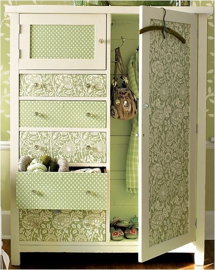 Easy enough.. The photo doesn't have a tutorial, but it looks like it's as simple as finding coordinating wallpaper swatches and covering an armoire or dresser in them. Very chic.