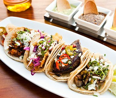 This Bay Area taqueria—with five locations, from North Beach down to Palo Alto—started in 2009 and prides itself on not offering burritos, a rarity in these parts. Instead, it focuses on tacos with hormone-free meats, sustainable seafood, and organic veggies: the signature taco is the roasted butternut squash with pasilla peppers, chicories, and spicy pumpkin seeds, but it also does a shot-and-a-beer-braised-chicken taco
