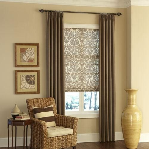 Layering your windows with Roman shades and draperies can help you achieve an elegant look with true depth.