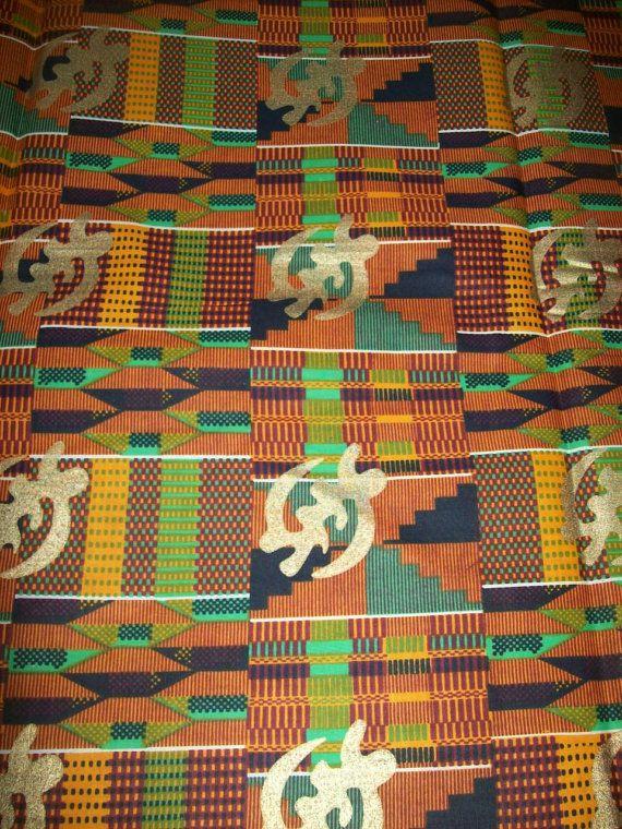 traditional kente cloth with gold metallic gye nyame