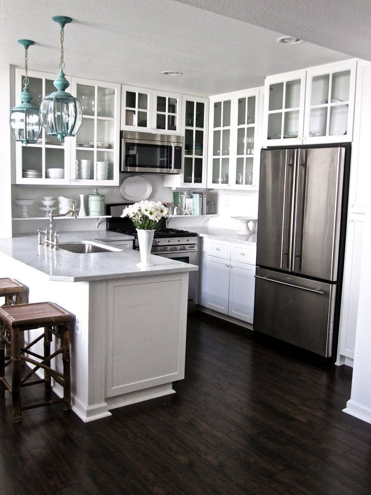 Gorgeous kitchen - love the light fixtures and floors!  Grace and Collin's Coastal Cottage — House Tour | Apartment Therapy