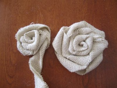 Burlap Flowers... looks like it could be relatively easy. We'll still have to see if I'm talented enough for this!
